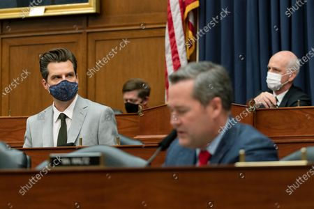 Rep. Matt Gaetz, R-Fla., left, attends a House Armed Services Committee hearing on Capitol Hill, in Washington. On the right is committee Chairman Rep. Adam Smith, D-Wash