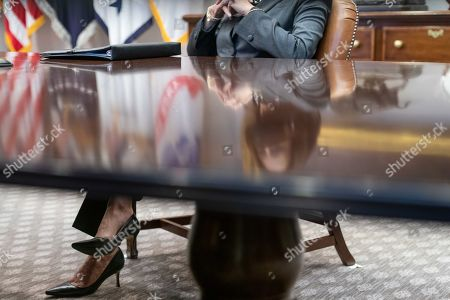 Vice President Kamala Harris's reflection is seen in the table of the Roosevelt Room of the White House Friday, March 12, 2021, during an American Rescue Plan virtual event with President Joe Biden to thank stakeholders and staff. (Official White House Photo by Lawrence Jackson) Kamala Harris