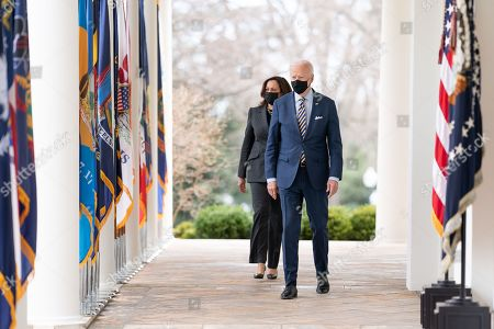Stock Picture of President Joe Biden and Vice President Kamala Harris walk from the Oval Office of the White House Friday, March 12, 2021, to the Rose Garden to deliver remarks on the American Rescue Plan. (Official White House Photo by Lawrence Jackson) Joe Biden