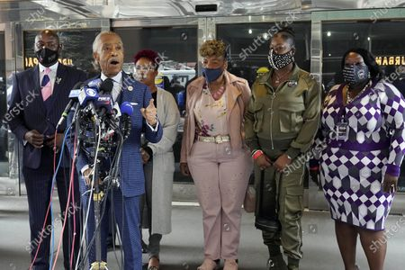 Rev. Al Sharpton, second left, and attorney Ben Crump, left, who represents the family of Daunte Wright, speak at a news conference in New York, . They are accompanied by Lesley McSpadden, mother of Michael Brown, third left; Gwen Carr, mother of Eric Garner, fourth left; Sybrina Fulton, mother of Trayvon Martin, fifth left; and Sequette Clark, mother of Stephon Clark