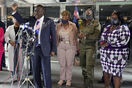 Attorney Ben Crump, foreground, who represents the family of Daunte Wright, speaks at a news conference in New York, . He is accompanied by Lesley McSpadden, mother of Michael Brown, left; Gwen Carr, mother of Eric Garner, third left; Sybrina Fulton, mother of Trayvon Martin, fourth left; and Sequette Clark, mother of Stephon Clark