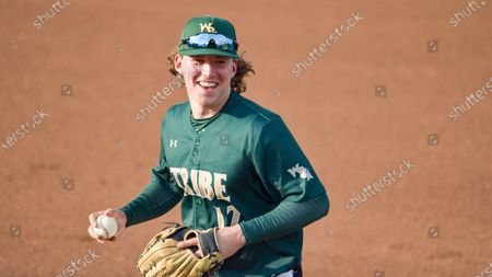 Stock Photo of William and Mary's Matt Thomas runs off the field after catching and the final out of the third inning during an NCAA baseball game on in Williamsburg, Va