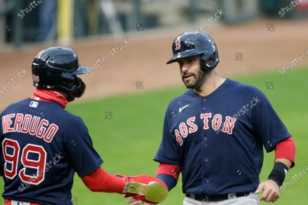 Boston Red Sox center fielder Alex Verdugo (99) congratulates left fielder J.D. Martinez (28) after both scored against the Minnesota Twins during the fifth inning in the second baseball game of a doubleheader, in Minneapolis