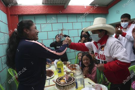 Stock Image of Presidential candidate of the Free Peru party Pedro Castillo greets a supporter in Chota, Peru, . Castillo and Keiko Fujimori, daughter of imprisoned ex-President Alberto Fujimori and candidate of the Popular Force party, will dispute the presidential run-off on June 6