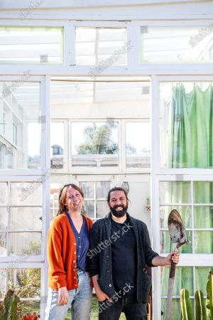 Portrait of Trevor Morris and Jenny Grosso in Atwater Village on Thursday, March 18, 2021 in Los Angeles , CA. With the help of a contractor friend, the couple built a greenhouse and social gathering area from unwanted windows collected from neighbors. It took 4 months to draw up the plans and only four days to build. (Mariah Tauger / Los Angeles Times)