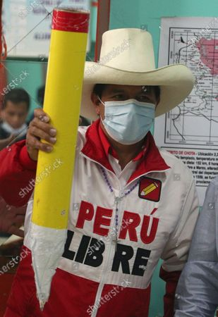 Presidential candidate of the Free Peru party Pedro Castillo holds a giant pencil as his party's symbol during a campaign stop in Chota, Peru, . Castillo and Keiko Fujimori, daughter of imprisoned ex-President Alberto Fujimori and candidate of the Popular Force party, will dispute the presidential run-off on June 6