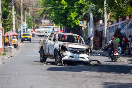 View of a car set on fire during protests in Port-au-Prince, Haiti, 14 April 2021. This morning Prime Minister of Haiti, Joseph Jouthe, resigned and this has left President Jovenel Moise isolated to face a serious wave of violence and the political crisis that has confronted the President with many sectors of society.