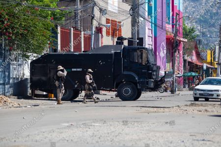 Authorities stand guard during protests in Port-au-Prince, Haiti, 14 April 2021. This morning Prime Minister of Haiti, Joseph Jouthe, resigned and this has left President Jovenel Moise isolated to face a serious wave of violence and the political crisis that has confronted the President with many sectors of society.