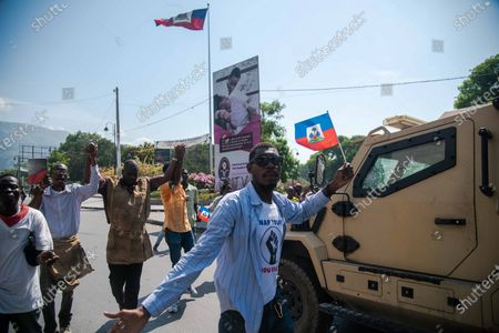 Demonstrators protest in Port-au-Prince, Haiti, 14 April 2021. This morning Prime Minister of Haiti, Joseph Jouthe, resigned and this has left President Jovenel Moise isolated to face a serious wave of violence and the political crisis that has confronted the President with many sectors of society.