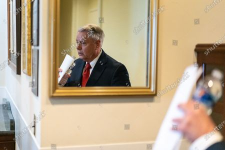 Sen. Lindsey Graham (R-SC) leaves a news conference in response to President Joe Biden's decision to pull all American troops out of Afghanistan by Sept. 11, 2021, on Capitol Hill on Wednesday, April 14, 2021 in Washington, DC. (Kent Nishimura / Los Angeles Times)