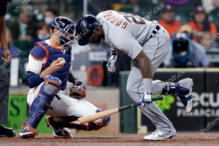 Detroit Tigers' Niko Goodrum (28) is brushed by on an inside pitch in front of Houston Astros catcher Jason Castro, left, during the second inning of a baseball game, in Houston