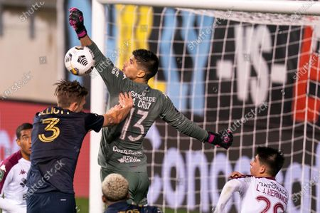 Deportivo Saprissa's Aaron Cruz, right, reaches for the ball as Philadelphia Union's Jake Elliott, left, tries to head the ball as he pushes Cruz during the second half of a CONCACAF Champions League soccer match, in Chester, Pa. The Union won 4-0
