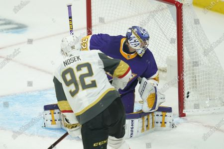 Vegas Golden Knights left wing Tomas Nosek (92) scores a goal against Los Angeles Kings goaltender Jonathan Quick (32) during the first period of an NHL hockey game, in Los Angeles