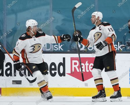 Anaheim Ducks center Ryan Getzlaf (15) is congratulated by Cam Fowler (4) after scoring a goal against the San Jose Sharks during the first period of an NHL hockey game, in San Jose, Calif