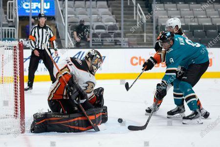 Anaheim Ducks goaltender Anthony Stolarz (41) blocks a shot by San Jose Sharks left wing Evander Kane (9) during the third period of an NHL hockey game, in San Jose, Calif