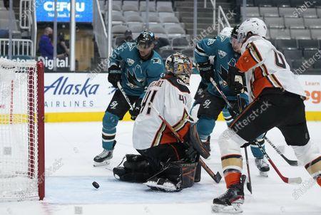 Anaheim Ducks goaltender Anthony Stolarz (41) can't make the stop on a goal by San Jose Sharks defenseman Erik Karlsson, not seen, during the third period of an NHL hockey game, in San Jose, Calif