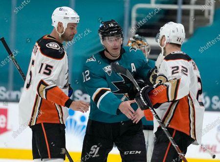 Anaheim Ducks defenseman Kevin Shattenkirk (22) and center Ryan Getzlaf (15) shakes hands with San Jose Sharks center Patrick Marleau (12) after an NHL hockey game, in San Jose, Calif