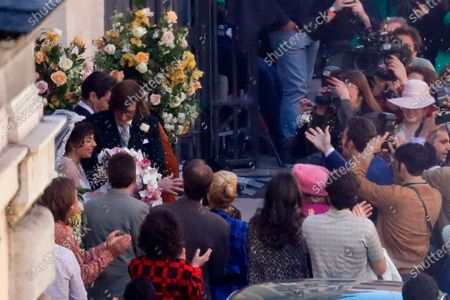 Stock Picture of Lady Gaga, wearing a wedding dress in background left, and Adam Driver, next to her, play Maurizio Gucci and his former wife Patrizia Reggiani during the shooting of a movie by Ridley Scott, based on the story of the murder of Maurizio Gucci in 1995, in Rome, . The great-grandchildren of Guccio Gucci, who founded the luxury brand nearly a century ago in Florence, are appealing to filmmaker Ridley Scott to respect their family's legacy in the film that focuses on the sensational murder