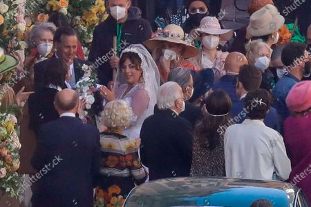 Stock Photo of Lady Gaga, wearing a wedding dress, plays Maurizio Gucci's former wife Patrizia Reggiani during the shooting of a movie by Ridley Scott, based on the story of the murder of Maurizio Gucci in 1995, in Rome, . The great-grandchildren of Guccio Gucci, who founded the luxury brand nearly a century ago in Florence, are appealing to filmmaker Ridley Scott to respect their family's legacy in the film that focuses on the sensational murder