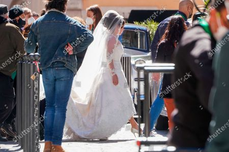 Lady Gaga, wearing a wedding dress, plays Maurizio Gucci's former wife Patrizia Reggiani during the shooting of a movie by Ridley Scott, based on the story of the murder of Maurizio Gucci in 1995, in Rome, . The great-grandchildren of Guccio Gucci, who founded the luxury brand nearly a century ago in Florence, are appealing to filmmaker Ridley Scott to respect their family's legacy in the film that focuses on the sensational murder