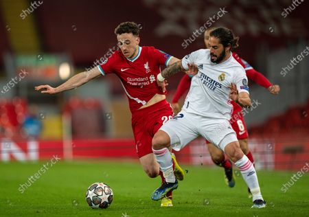 Liverpool's Diogo Jota (L) traps Real Madrid's Isco