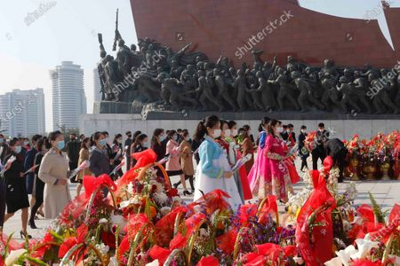 People visit the Mansu Hill to lay floral baskets and bouquets at the statues of their late leaders Kim Il Sung and Kim Jong Il on the occasion of the Day of the Sun, the birth anniversary of Kim Il Sung, in Pyongyang, North Korea