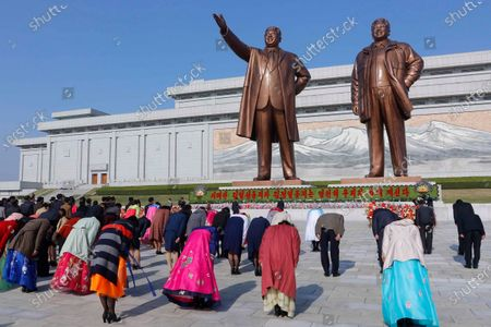People visit the statues of their late leaders Kim Il Sung and Kim Jong Il on the occasion of the Day of the Sun, the birth anniversary of Kim Il Sung, in Pyongyang, North Korea