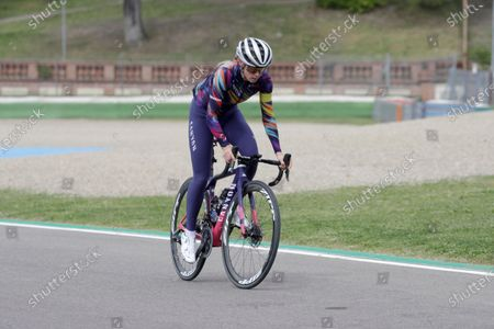 Australian cyclist Tiffany Cromwell, partner of Mercedes driver Valtteri Bottas, pedals around the racetrack while pilots arrive to inspect it ahead of Sunday's Emilia Romagna Formula One Grand Prix, at the Imola track, Italy