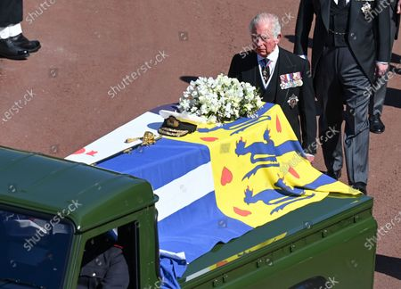 The coffin of Prince Philip on the back of the Land Rover with Prince Charles walking behind