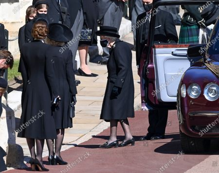 Queen Elizabeth II as Catherine Duchess of Cambridge and Camilla Duchess of Cornwall look on
