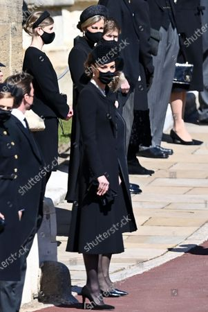 Catherine Duchess of Cambridge and family members await the arrival of the coffin