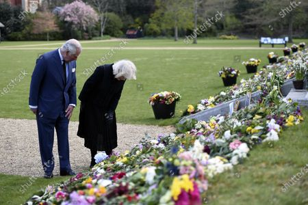 Britain's Prince Charles and Camilla, Duchess of Cornwall visit the gardens of Marlborough House, London, to look at the flowers and messages left by members of the public outside Buckingham Palace, following the death of Prince Philip