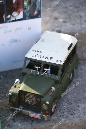 A model Land Rover left by a member of the public outside Buckingham Palace following the death of the Duke of Edinburgh on display in the gardens of Marlborough House, London, during a visit by the Prince of Wales and the Duchess of Cornwall.