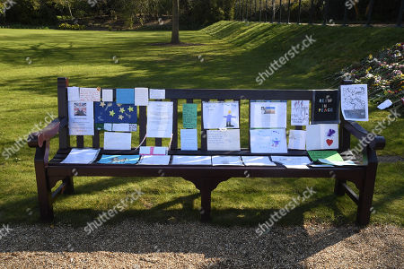 Notes left by members of the public outside Buckingham Palace following the death of the Duke of Edinburgh on display in the gardens of Marlborough House, London, during a visit by the Prince of Wales and the Duchess of Cornwall.