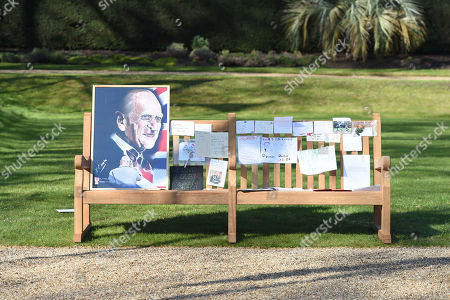 Notes and artwork left by members of the public outside Buckingham Palace following the death of the Duke of Edinburgh on display in the gardens of Marlborough House, London, during a visit by the Prince of Wales and the Duchess of Cornwall.