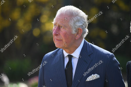 Prince Charles visits the gardens of Marlborough House, London, to view the flowers and messages left by members of the public outside Buckingham Palace following the death of the Duke of Edinburgh on April 10.