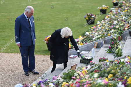 Stock Image of Prince Charles and Camilla Duchess of Cornwall visit the gardens of Marlborough House, London, to view the flowers and messages left by members of the public outside Buckingham Palace following the death of the Duke of Edinburgh on April 10.