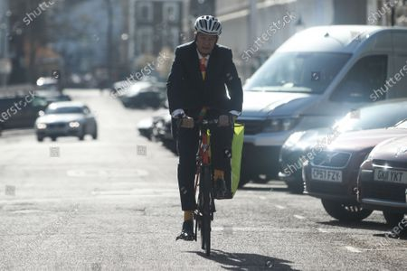 Jon Snow is seen riding his bicycle in Primrose Hill