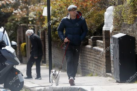 Comedian Russell Howard is seen walking his dog in Primrose Hill
