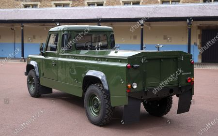 """The Jaguar Land Rover that will be used to transport the coffin of the Duke of Edinburgh at his funeral on Saturday, is pictured at Windsor Castle, in Berkshire, England, . The modified Land Rover Defender TD5 130 chassis cab vehicle was made at Land Rover's factory in Solihull in 2003 and Philip oversaw the modifications throughout the intervening years, requesting a repaint in military green and designing the open top rear and special """"stops"""" to secure his coffin in place"""