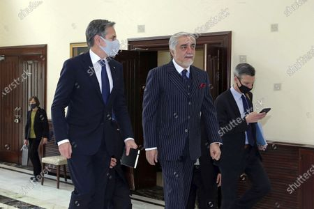 Abdullah Abdullah, Chairman of the High Council for National Reconciliation, center, walks with U.S. Secretary of State Antony Blinken, at the Sapidar Palace in Kabul, Afghanistan, . Blinken made an unannounced visit to Afghanistan on Thursday to sell Afghan leaders and a wary public on President Joe Biden's decision to withdraw all American troops from the country and end America's longest-running war