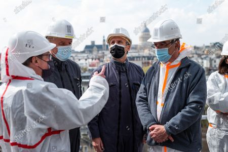 French President Emmanuel Macron, architect in charge of the restoration Philippe Villeneuve (2nd R), Jean-Louis Georgelin, trained general leading the restoration efforts, Paris' Archbishop Michel Auand Paris' mayor Anne Hidalgo visit of Notre-Dame de Paris Cathedral two years since the blaze that made the spire collapse and much of the roof, in Paris on April 15, 2 2021. The actual restoration work has yet to begin as time up until now has been strengthened on securing the building, and the full restoration works should begin early next year.
