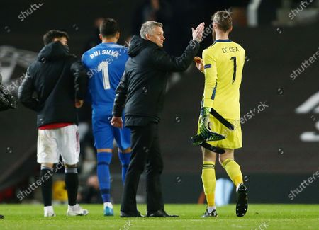 Manchester United manager Ole Gunnar Solskjaer with goalkeeper David De Gea at the end of the game