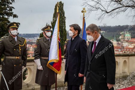 Stock Picture of Czech Prime Minister Andrej Babis (R) and his Slovak counterpart Eduard Heger (2-R) inspect an honor guard during a welcome ceremony in Prague, Czech Republic, 15 April 2021. Heger is on an official visit to the Czech Republic.