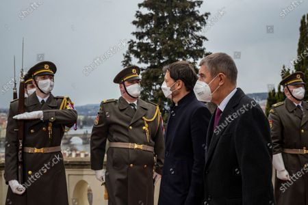Stock Image of Czech Prime Minister Andrej Babis (front) and his Slovak counterpart Eduard Heger (3-R) inspect an honor guard during a welcome ceremony in Prague, Czech Republic, 15 April 2021. Heger is on an official visit to the Czech Republic.