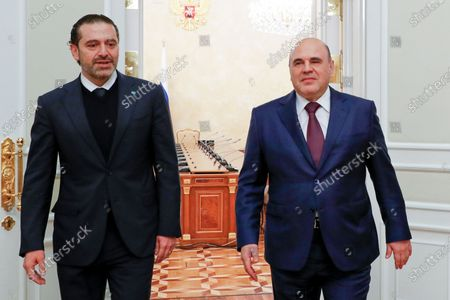 Russian Prime Minister Mikhail Mishustin, right, and Lebanese Prime Minister-Designate Saad Hariri enter a hall for their talks in Moscow, Russia