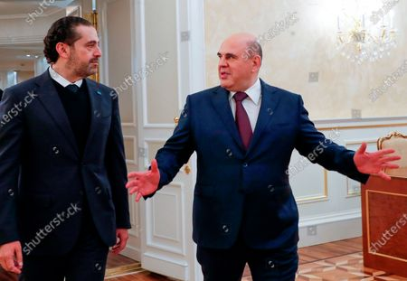 Russian Prime Minister Mikhail Mishustin, right, gestures speaking to Lebanese Prime Minister-Designate Saad Hariri as they enter a hall for their talks in Moscow, Russia