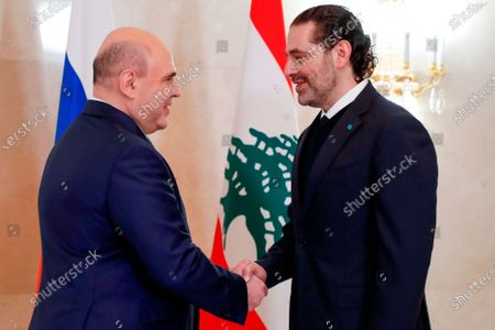 Russian Prime Minister Mikhail Mishustin, left, and Lebanese Prime Minister-Designate Saad Hariri great each other prior to their talks in Moscow, Russia