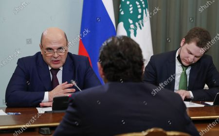 Stock Image of Russian Prime Minister Mikhail Mishustin (L) and Lebanese Prime Minister Saad Hariri (C, back to camera) attend a meeting at the House of the Russian Government in Moscow, Russia, 15 April 2021. Lebanese Prime Minister is on a working visit in Moscow.