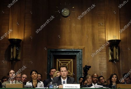 This photo from, shows Harry Markopolos, far left, a fraud investigator, listening to testimony from Securities and Exchange Commission (SEC) Inspector General David Kotz, center, on Capitol Hill during a Senate banking Committee hearing on Bernard Madoff. The SEC failed to heed credible warnings over 10 years about Madoff, before his Ponzi scheme came crashing down